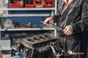 mechanic repairs a head gasket